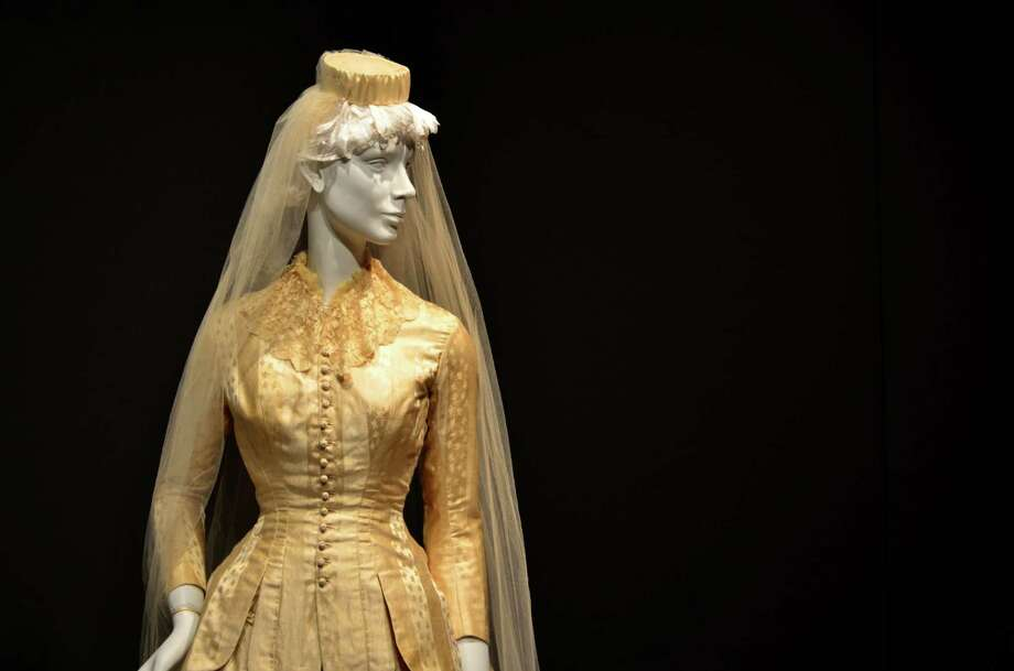 Dozens of dresses were  donated to the Darien Historical Society for its latest exhibit, Here Come the Brides, which features 21 wedding dresses from 1855 to 1950. Photo: Megan Spicer / Darien News