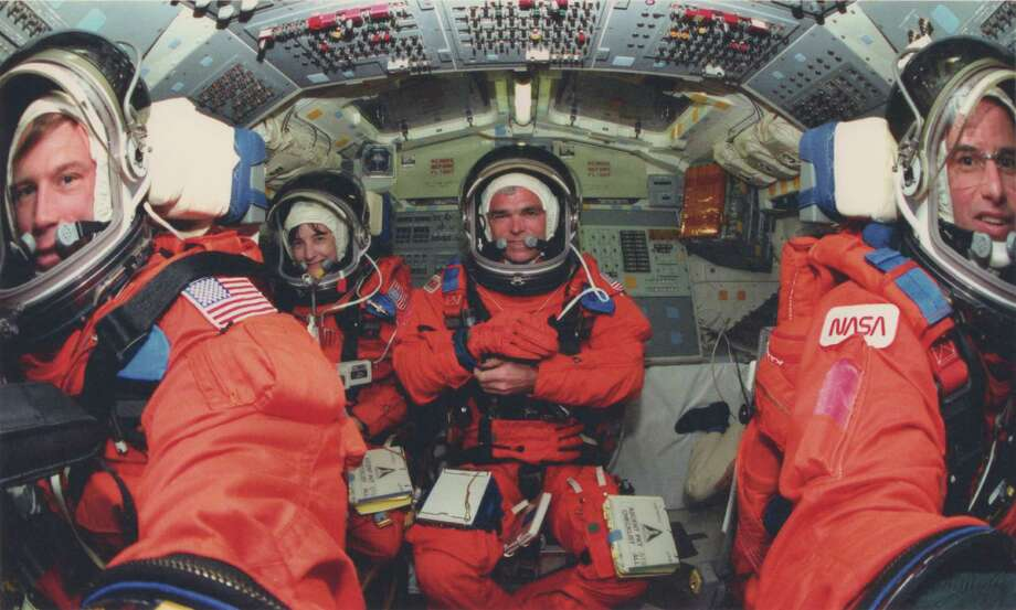 "The crew of STS-76 included, from left, Richard Searfoss, Linda Godwin (who performed the spacewalk with Clifford), Michael ""Rich"" Clifford and Commander Kevin Chilton (the only member of the crew who knew about Clifford's disease). The crew also included Ronald Sega and Shannon Lucid, not pictured. Photo: Courtesy Of  NASA"