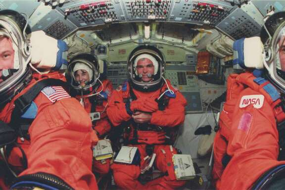 "The crew of STS-76 included, from left, Richard Searfoss, Linda Godwin (who performed the spacewalk with Clifford), Michael ""Rich"" Clifford and Commander Kevin Chilton (the only member of the crew who knew about Clifford's disease). The crew also included Ronald Sega and Shannon Lucid, not pictured."