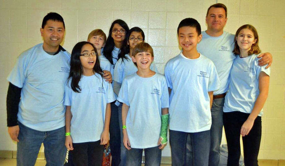 "The Middlesex Middle Schol ""Stackable Structures"" team from Darien is advanced to the World Finals of the Odyssey of the Mind program in May. From left, coach Clem Garcia, Tala Garcia, Jack Massey, coach Arpita Muchhal, Aria Muchhal, Pierce Leclerc, Richard Huang, coach Real Leclerc and Isabelle Leclerc. Photo: Contributed Photo, Contributed / Darien News"