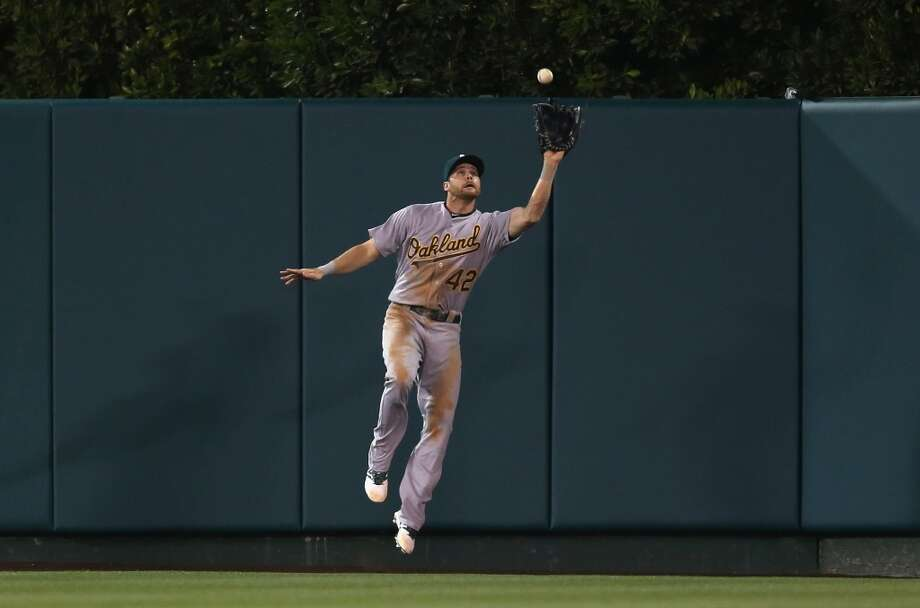 Center fielder Craig Gentry of the Oakland Athletics makes a catch on a ball hit by Albert Pujols (not pictured) of the Los Angeles Angels of Anaheim in the seventh inning at Angel Stadium of Anaheim on April 15, 2014 in Anaheim, California. Photo: Jeff Gross, Getty Images