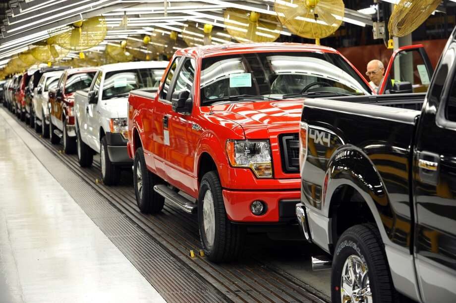 Ford F-150 pickup trucks, some equipped for conversion to compressed natural gas fuel, roll off Ford Motor Co.'s Kansas City Assembly Plant in Claycomo, Mo. Photo: Ford Motor Co.