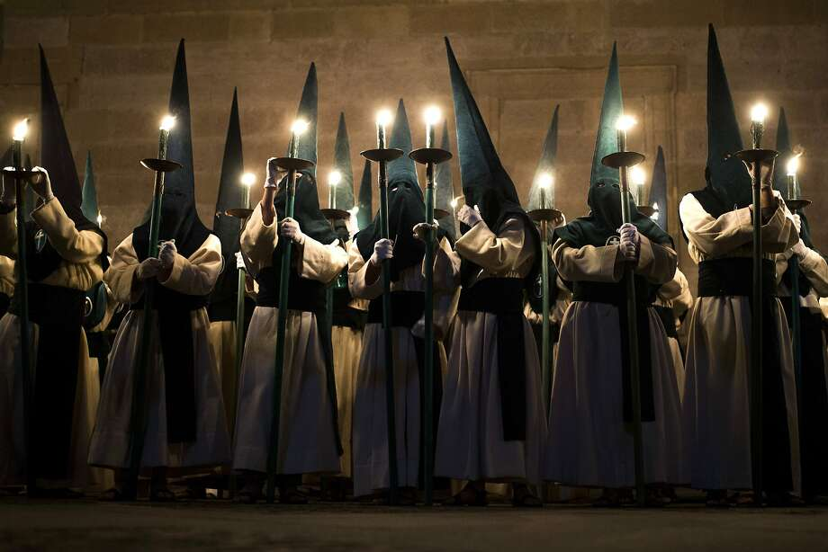 Penitents from 'Las Siete Palabras' 'Seven words' brotherhood take part in a procession in Zamora, Spain, on the early hours of Wednesday, April 16, 2014. Hundreds of processions take place throughout Spain during the Easter Holy Week. Photo: Andres Kudacki, Associated Press
