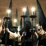Penitents from 'Las Siete Palabras' 'Seven words' brotherhood take part in a procession in Zamora, Spain, on the early hours of Wednesday, April 16, 2014. Hundreds of processions take place throughout Spain during the Easter Holy Week.