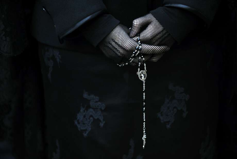 """A penitent takes part in the procession of the """"Silencio y la Santa Cruz"""" brotherhood during Holy Week in Oviedo, northern Spain April 15, 2014. Hundreds of processions take place round-the-clock during Holy Week in Spain, drawing thousands of visitors. Photo: Eloy Alonso, Reuters"""