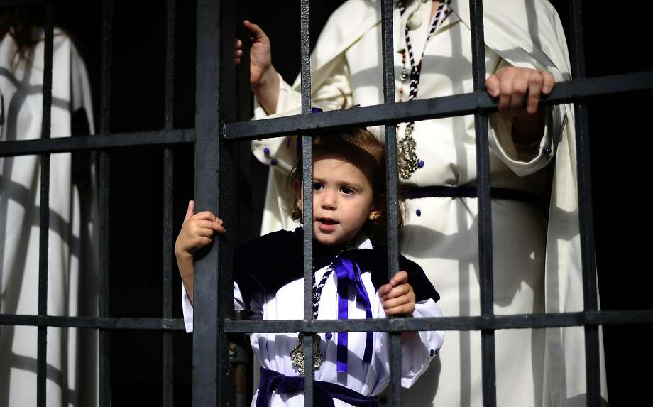 "A child from ""La Sangre"" brotherhood takes part during a Holy Week procession in Cordoba, southern Spain, Spain, Tuesday, April 15, 2014. Hundreds of processions take place throughout Spain during the Easter Holy Week. Photo: Manu Fernandez, Associated Press"