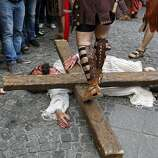 "Actors take part in a re-enactment of the ""Via Crucis"" (Way of the Cross), which commemorates the crucifixion of Jesus Christ, during the Orthodox Holy Week celebrations in Bucharest April 15, 2014. Romania's Christian Orthodox majority will celebrate Easter on April 20 together with Catholic believers."