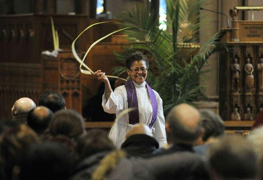 Rev. Kathleen Berkowe gives the Palm Sunday sermon at St. John's Episcopal Church in Stamford on Sunday, March 24, 2013. Photo: Jason Rearick