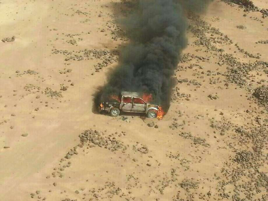 This aerial photo shows a truck burning after a Jordanian air strike on a convoy at the border between Jordan and Syria on Wednesday, April 16, 2014. Jordanian military warplanes struck a convoy of vehicles as they were trying to enter Jordan from Syria, the army said in a statement Wednesday, in an unusual move at a time of tensions between the desert kingdom and Damascus.(AP Photos/Ammonnews) Photo: Uncredited, Associated Press