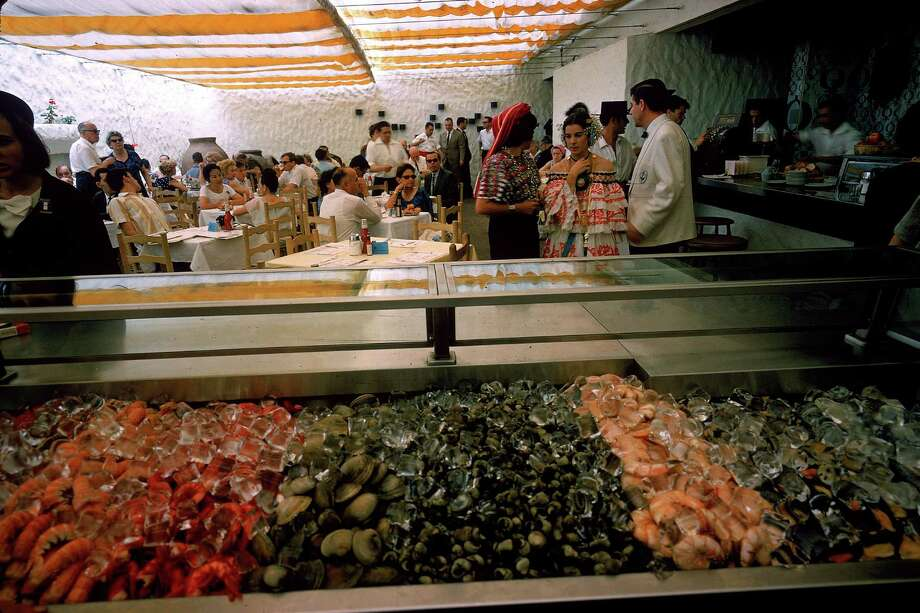 Various kinds of shellfish, including shrimp and oysters, line a counter at the Taberna Marisqueria, a patio cafe in the Spanish Pavillion at the World's Fair, mid 1964, Queens, New York. Photo: Mark Kauffman, Time & Life Pictures/Getty Image / Time Life Pictures