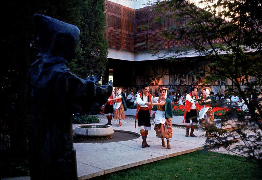 Members of Coros y Danzas dance on the patio at the Spanish Pavillion during an exhibition at the World's Fair, Queens, New York, mid 1964. The statue in the foreground is of Franciscan friar Junipero Serra. Photo: Mark Kauffman, Time & Life Pictures/Getty Image / Time Life Pictures