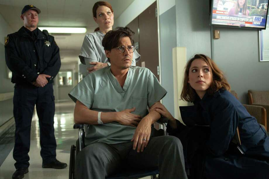"""This photo released by Warner Bros. shows Johnny Depp, left, as Will Caster and Rebecca Hall as Evelyn Caster, in Alcon Entertainment's sci-fi thriller """"Transcendence,"""" a Warner Bros. Pictures release. The movie releases in the U.S. on April 18, 2014. (AP Photo/Alcon Entertainment-Warner Bros., Peter Mountain) ORG XMIT: CAET169 Photo: Peter Mountain / Warner Bros. Pictures"""