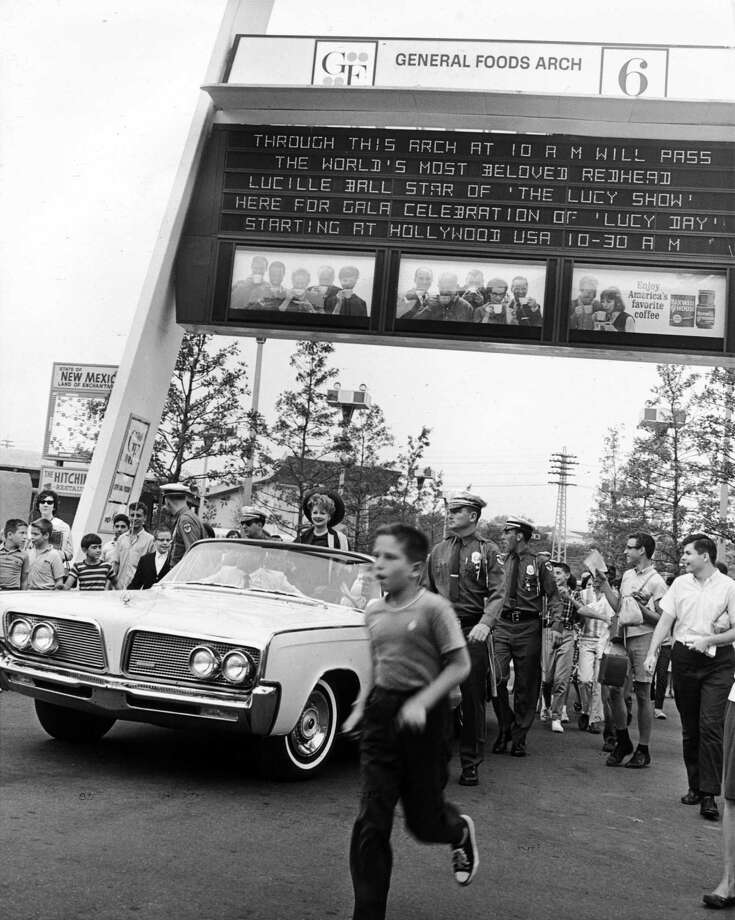 American actress Lucille Ball arrives at the New York World's Fair for 'Lucy Day', August 31, 1964. Here she passes beneath the General Foods Arch, with a message lauding her as 'the world's most beloved redhead'. Photo: Pictorial Parade, Getty Images / 2010 Getty Images