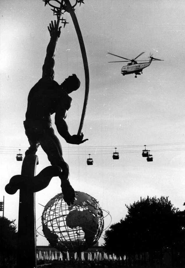 A view of a helicopter in flight above the World's Fair site, New York, New York, mid 1960s. Photo: Weegee(Arthur Fellig)/Internatio, Getty Images / ICP