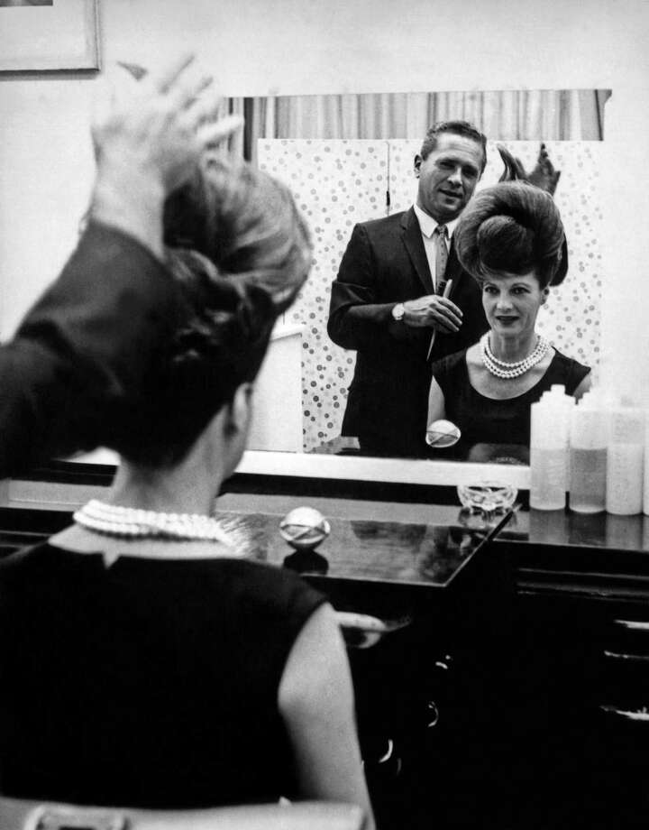 Ann Corio, star of 'This Was Burlesque,' watches in the mirror as stylist John Fonda puts the finishing touches on 'The Unisphere Hairdo,' inspired by the official symbol of the 1964 World's Fair, New York, New York, 1964. Photo: Underwood Archives, Getty Images / Archive Photos