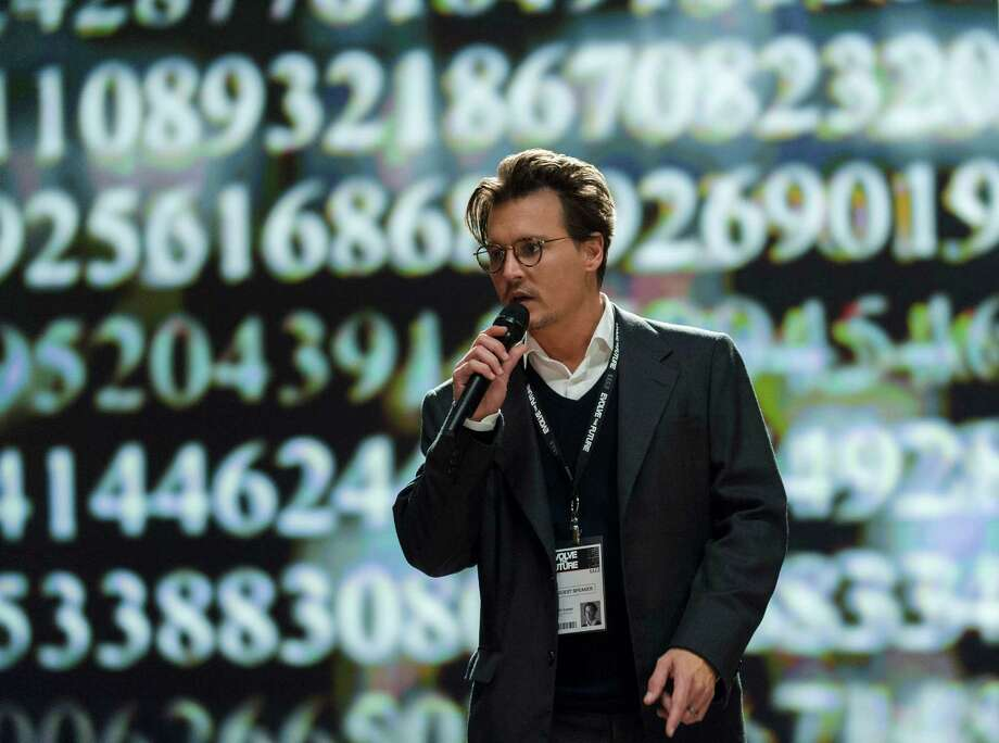 "This photo released by Warner Bros. shows Johnny Depp as Will Caster in Alcon Entertainment's sci-fi thriller ""Transcendence,"" a Warner Bros. Pictures release.  The movie releases in the U.S. on April 18, 2014. (AP Photo/Alcon Entertainment-Warner Bros. Pictures, Peter Mountain) ORG XMIT: CAET170 Photo: Peter Mountain / Warner Bros. Pictures"