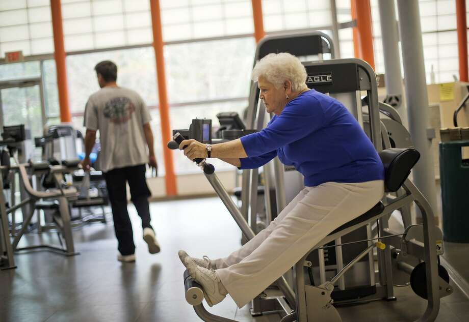 Sarah Luke, 73, of Kennesaw, Ga., who was diagnosed with diabetes six years ago, works out as part of a new exercise program at her local YMCA, Friday, April 4, 2014, in Kennesaw, Ga. With many consumers getting health insurance for the first time through the federal marketplace, insurers are finding creative ways to treat one of the most common diseases they're encountering, diabetes. Insurers are trying to quickly pinpoint new enrollees with diabetes and connect them with a doctor, diet plan and other disease management services. Before the Affordable Care Act, insurers could reject people with pre-existing conditions. But now insurers are required to take all comers and can't charge them extra, companies know that keeping consumers healthy will cost them less in the long run. (AP Photo/David Goldman) Photo: David Goldman, Associated Press
