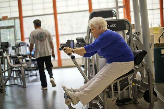 Sarah Luke, 73, of Kennesaw, Ga., who was diagnosed with diabetes six years ago, works out as part of a new exercise program at her local YMCA, Friday, April 4, 2014, in Kennesaw, Ga. With many consumers getting health insurance for the first time through the federal marketplace, insurers are finding creative ways to treat one of the most common diseases they're encountering, diabetes. Insurers are trying to quickly pinpoint new enrollees with diabetes and connect them with a doctor, diet plan and other disease management services. Before the Affordable Care Act, insurers could reject people with pre-existing conditions. But now insurers are required to take all comers and can't charge them extra, companies know that keeping consumers healthy will cost them less in the long run. (AP Photo/David Goldman)