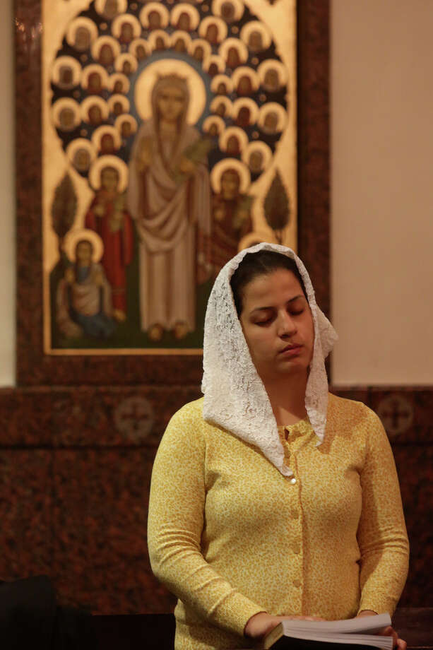 Angie Salama prays during Evening Pascha for Holy Week at St. Antony The Great Coptic Orthodox Church in San Antonio on Tuesday, April 15, 2014. Photo: Lisa Krantz, SAN ANTONIO EXPRESS-NEWS / SAN ANTONIO EXPRESS-NEWS