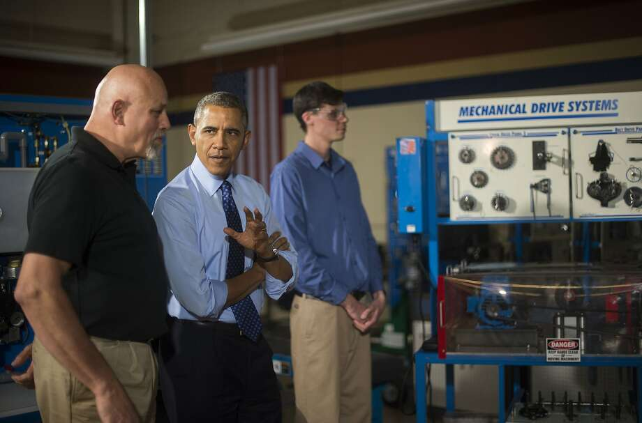 President Obama speaks with an instructor during a tour of a community college in Oakdale, Pa. Photo: Jim Watson, AFP/Getty Images