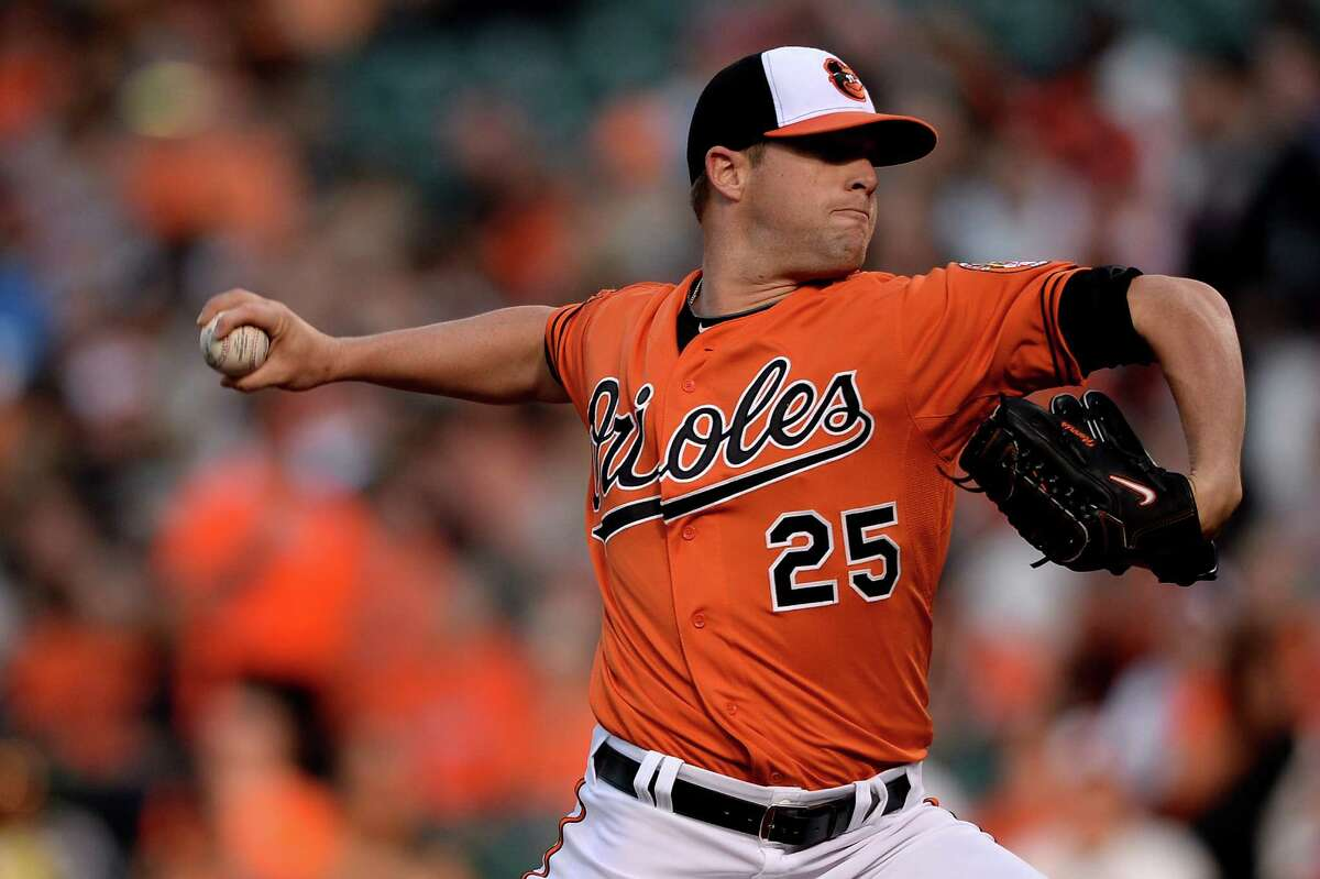 BALTIMORE, MD - APRIL 12: Starting pitcher Bud Norris #25 of the Baltimore Orioles works the first inning against the Toronto Blue Jays at Oriole Park at Camden Yards on April 12, 2014 in Baltimore, Maryland. (Photo by Patrick Smith/Getty Images) ORG XMIT: 477579989