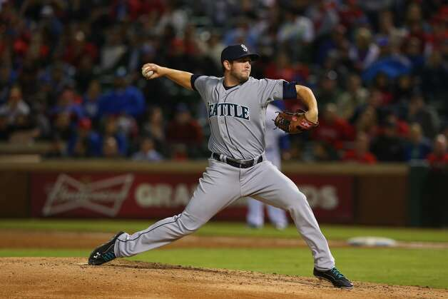 Dominic Leone of the Seattle Mariners throws against the Texas Rangers in the 5th inning at Globe Life Park in Arlington on April 15, 2014. Leone, who was born in Norwich, made his Major League debut in 2014.