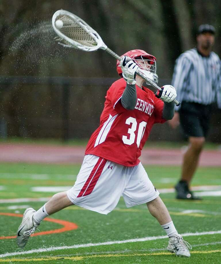 Greenwich High School goaltender Tommy Rogan fires a long pass in a rain-swept game against Ridgefield High School, played at Ridgefield. Tuesday, April 15, 2014 Photo: Scott Mullin / The News-Times Freelance