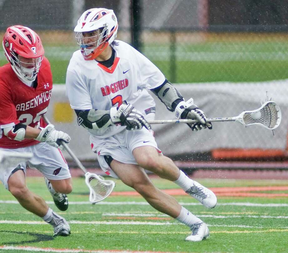 Ridgefield High School's Chad Krys looks to fire a shot in a game against Greenwich High School, played at Ridgefield. Tuesday, April 15, 2014 Photo: Scott Mullin / The News-Times Freelance