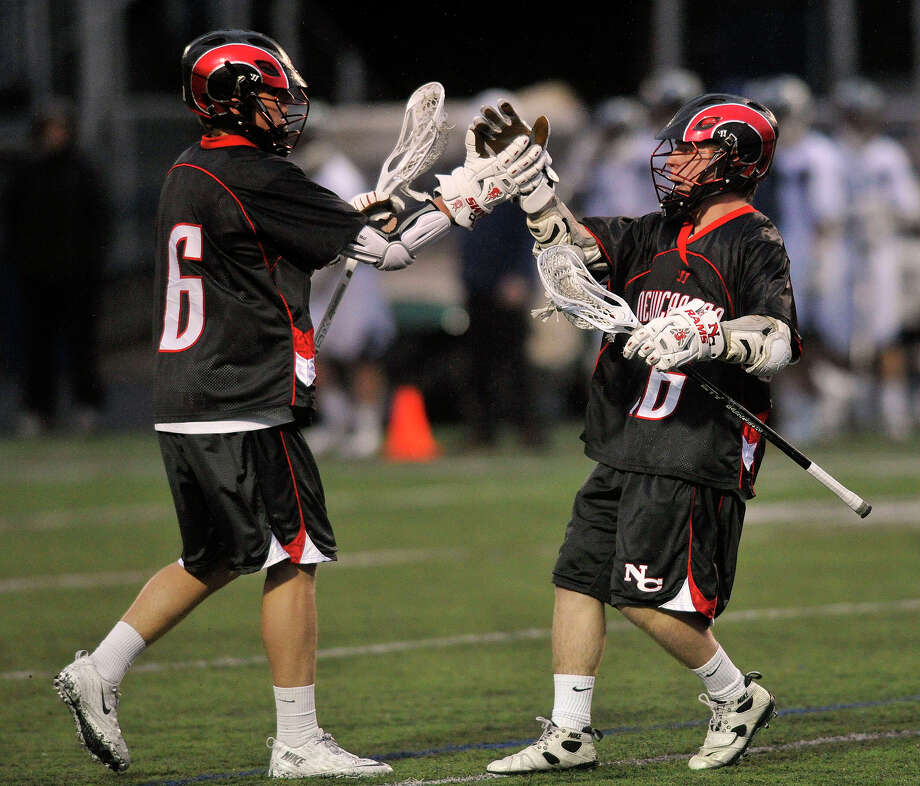 New Canaan's Michael Kraus, left, congratulates Henry Stanton after Stanton scored in the first hald during their lacrosse game against Wilton at Wilton High School in Wilton, Conn., on Tuesday, April 15, 2014. Photo: Jason Rearick / Stamford Advocate