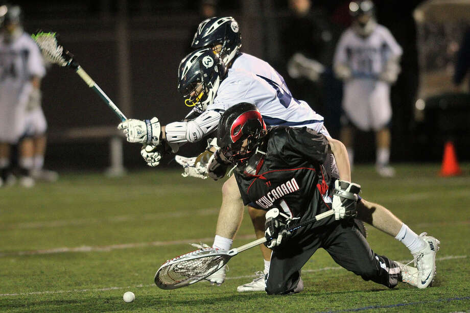 New Canaan goalie Trent Nader tries to keep the loose ball from Wilton's Michael Lynch during their lacrosse game at Wilton High School in Wilton, Conn., on Tuesday, April 15, 2014. Photo: Jason Rearick / Stamford Advocate