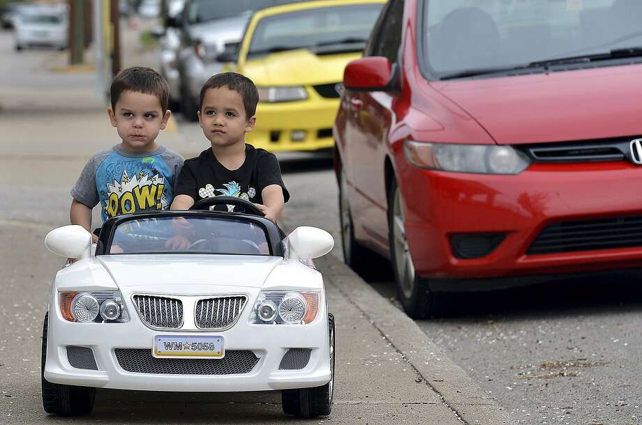 Pedestrians! They think they own the sidewalk! Dallas Smith, 3, makes a face as big 