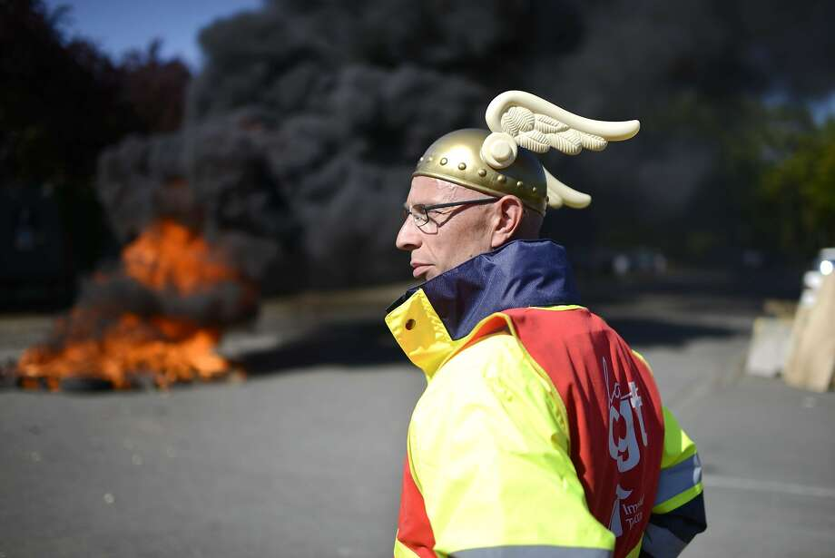 Jobs go up in smoke:An employee of the Seita-Imperial Tobacco plant in Carquefou, France,   wears the symbolic helmet of the Gallic comic book hero Asterix during a protest at the   entrance of the factory. Citing declining sales in Europe, tougher anti-smoking measures   and the growth of contraband sales, Imperial Tobacco announced the closure of factories in   Britain and France with the loss of 900 jobs. Photo: Jean-Sebastien Evrard, AFP/Getty Images