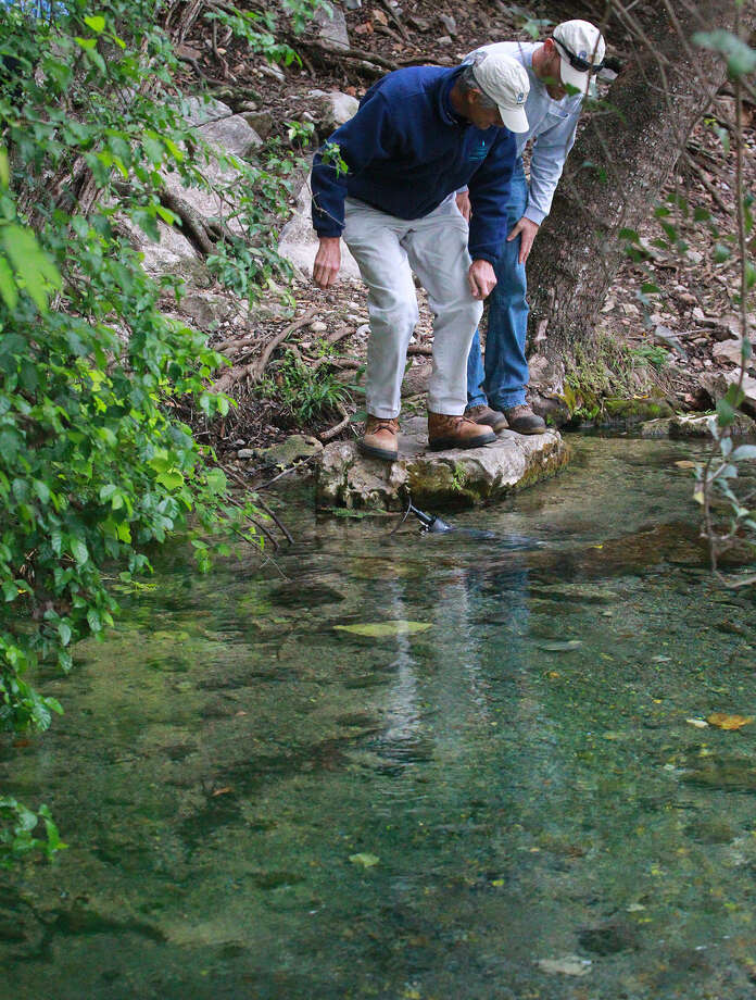 Edwards Aquifer Authority hydrogeologist supervisor Steve Johnson (left) and EAA environmental science technician Thomas Marsalia recently inspect water at Comal Springs in New Braunfels. With aquifer levels low due to the continuing drought, readers address conservation efforts. Photo: John Davenport / San Antonio Express-News / ©San Antonio Express-News