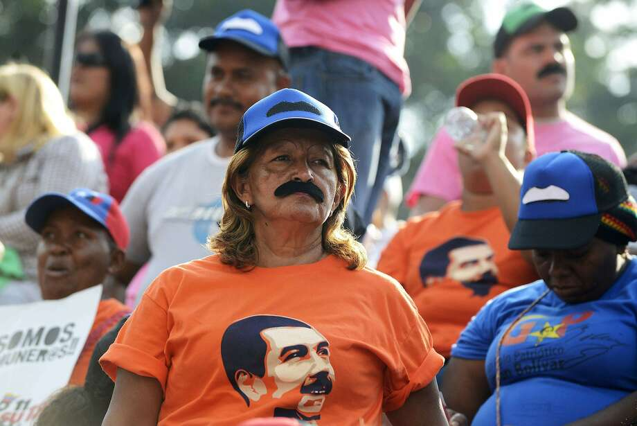Giving lip service to the prez:Mustaches come out in force at a rally for Venezuelan President Nicolas Maduro,   who was celebrating his first year in office at Miraflores presidential palace in   Caracas. Photo: Frederico Parra, AFP/Getty Images