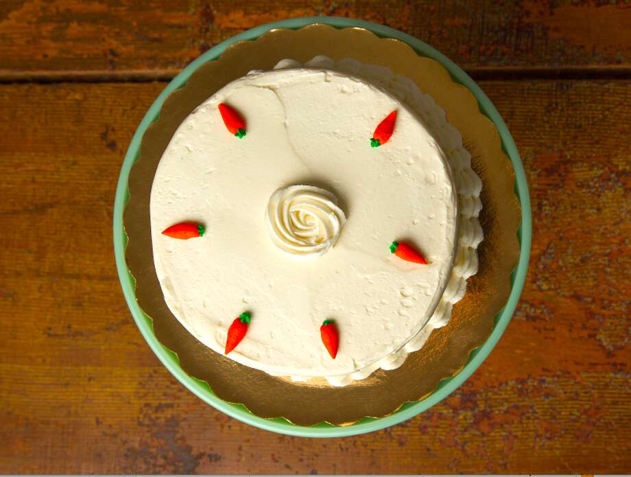"""Classic carrot cake from Sweet & Simple in Fairfield: The classic carrot cake has cream cheese frosting, sides covered in chopped walnuts, petite carrot decorations on top with the words """"Happy Easter"""".  See the full Easter menu  Sweet & Simple, 75 Hillside Road, Fairfield"""
