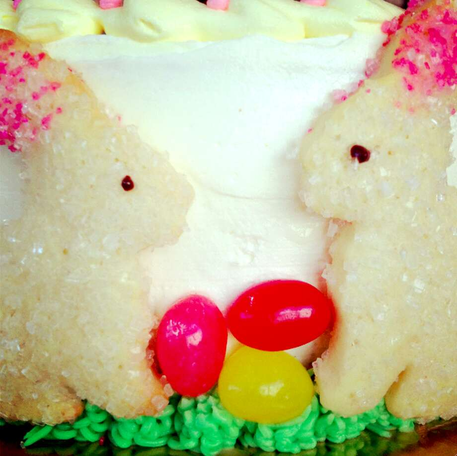 """Hippity Hop Cake from Sweet & Simple in Fairfield: Signature yellow cake with fluffy vanilla buttercream, buttercream """"grass"""" with sugar cookie bunnies and jelly beans. On top, a Sugar Cookie Easter Egg with the words """"Hoppy Easter."""" You can order extra bunnies so every child has one with their cake.  See the full Easter menu  Sweet & Simple, 75 Hillside Road, Fairfield"""
