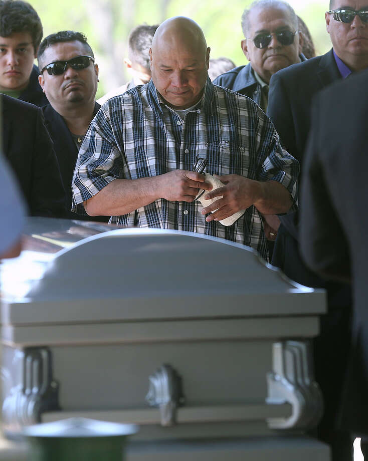 Tony Ayala, Jr. watches as his father Tony Ayala Sr. is remembered at funeral services at Palm Heights Mortuary and Ft. Sam Houston National Cemetery on April 16, 2014. Photo: TOM REEL