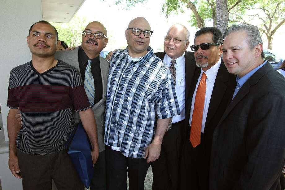 The four Ayala brothers . (from left , Paulie , Sam, Tony, Jr. and Mike second from right) stand for pictures as Tony Ayala Sr. is remembered at funeral services at Palm Heights Mortuary and Ft. Sam Houston National Cemetery on April 16, 2014. Photo: TOM REEL