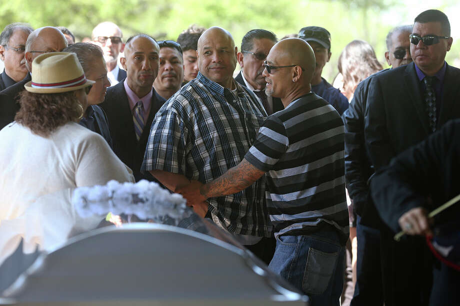 Supporters move in to console Tony Ayala, Jr. as Tony Ayala Sr. is remembered at funeral services at Palm Heights Mortuary and Ft. Sam Houston National Cemetery on April 16, 2014. Photo: TOM REEL