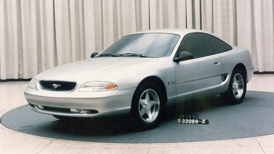 "In 1990, Ford designers evaluated a number of themes for a replacement for the long-running third-generation Mustang. The notchback and hatchback bodystyles would be replaced with a single fastback coupe format. After departing from many of the original design cues on the third-generation models, the upcoming fourth-generation would return elements like the galloping pony in the grille, the side scoops and the tri-bar taillamps. This softer concept, known as ""Bruce Jenner"" wasn't considered aggressive enough to be a Mustang. Photo: Ford Motor Company"