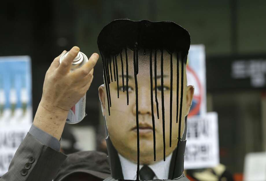 Just For Strongmen®: A South Korean protester adds some color to Kim Jong Un's coif during an anti-North Korea rally in Seoul. Photo: Lee Jin-man, Associated Press