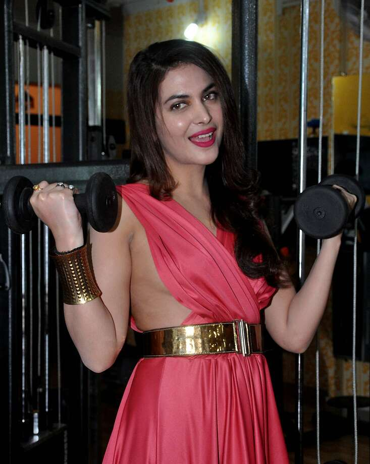 Loading up her guns:Indian actress and model Ankita Shorey chooses a risky outfit for bicep curls while launching a new gym in Mumbai. Photo: Strdel, AFP/Getty Images