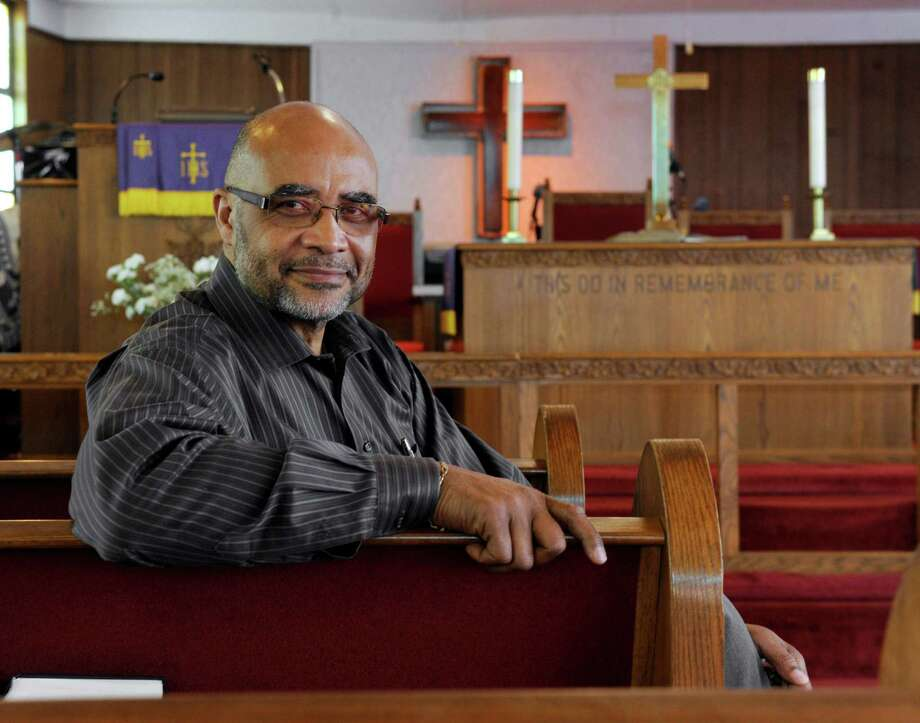 Rev. Lloyd McKenzie is the pastor of Mt. Pleasant A.M.E. Zion Church on Rowan Street in Danbury, Conn. He is photographed in the church sanctuary Monday, April 14, 2014. The church is celebrating the 125th anniversary of its founding. Photo: Carol Kaliff / The News-Times