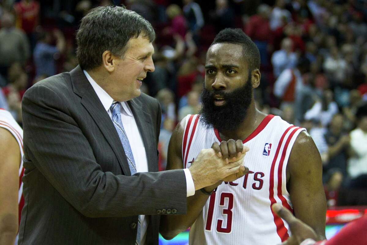 Houston Rockets head coach Kevin McHale, left, celebrates the Rockets 104-98 win over the San Antonio Spurs with Rockets guard James Harden (13) during the second half of an NBA basketball game at Toyota Center Monday, April 14, 2014, in Houston.