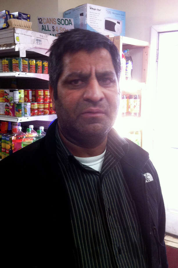 Aslam Khawaja, the owner of the SK Grocery at 856 Fairfield Ave., in Bridgeport, is accused of illegally using government food stamp money to buy 1,200 cases of Red Bull. He is charged Wednesday with first-degree larceny by defrauding a public community, a felony punishable by up to 20 years in prison. Photo: Contributed Photo / Connecticut Post Contributed
