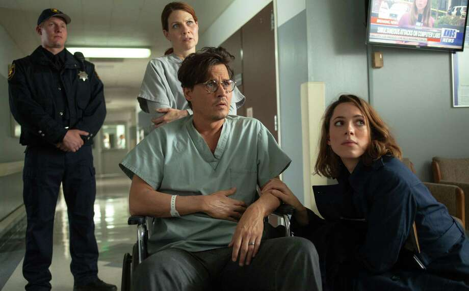 The characters played by Johnny Depp and Rebecca Hall (foreground) give scientists a bad name. Photo: Warner Bros. Pictures / Warner Bros. Pictures