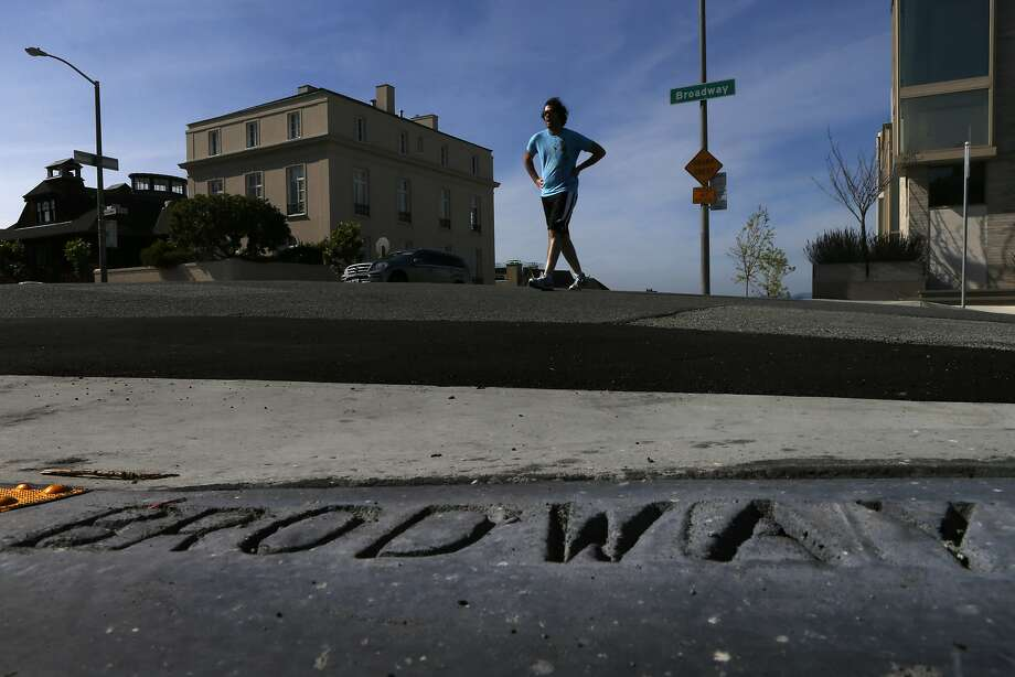"The corner of Broadway and Divisadero Street is stamped with a typo, one of many such errors in San Francisco. The mistake has since been corrected, as has the misspelling ""BROADWEY"" on another corner. Photo: Carlos Avila Gonzalez, The Chronicle"