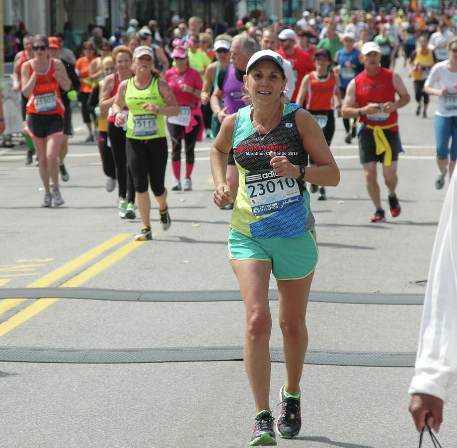 Fairfielder Katina Wolfe, shown here in last year's Boston Marathon, plans to run again in the event Monday. Photo: Contributed Photo / Fairfield Citizen