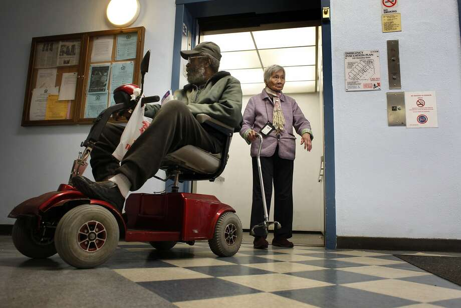 Solomon Watkins, 76, backs his scooter into an elevator at the Clementina Towers public housing. Watkins is one of the tenants involved in a pending suit against the Housing Authority. Photo: Lacy Atkins, SFC