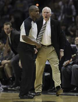 San Antonio Spurs head coach Gregg Popovich chases official Derrick Collins after he is called for a technical foul during the second half against the Memphis Grizzlies at the AT&T Center, Sunday, April 6, 2014. The Spurs won 112-92. Photo: Jerry Lara, San Antonio Express-News